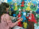 Fátima Camargo pintou dois quadros sobre Meio Ambiente ao mesmo tempo